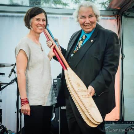 Senator Murray Sinclair accepts his paddle as Honorary Riverkeeper
